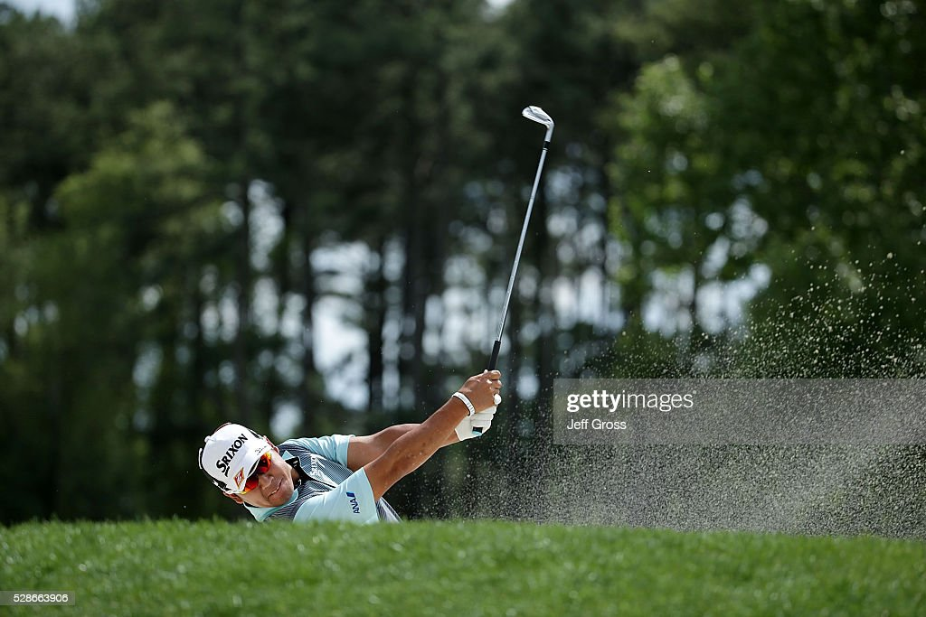 Hideki Matsuyama of Japan hits his approach shot on the ninth hole during the second round of the Wells Fargo Championship at Quail Hollow Club on...