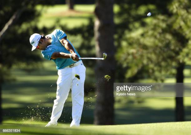 Hideki Matsuyama of Japan hits his second shot on the 17th hole during the third round of the Masters Tournament at Augusta National Golf Club on...