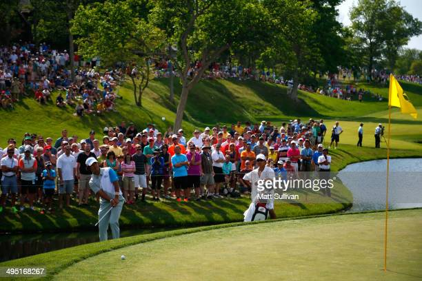 Hideki Matsuyama of Japan hits his third shot on the 14th hole during the final round of the Memorial Tournament presented by Nationwide Insurance at...