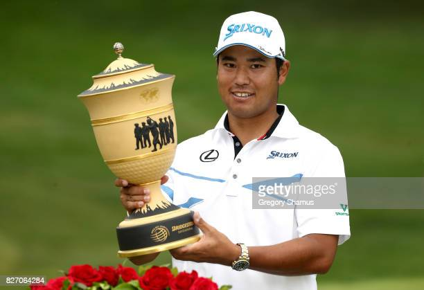 Hideki Matsuyama of Japan holds the Gary Player Cup after winning the World Golf Championships Bridgestone Invitational during the final round at...