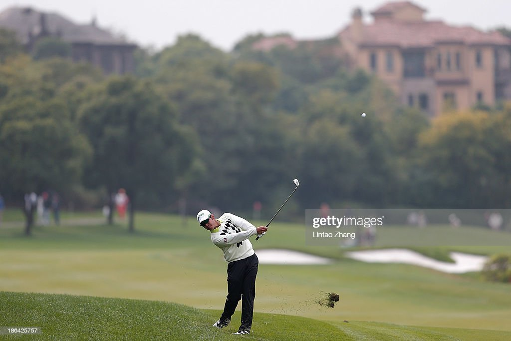 <a gi-track='captionPersonalityLinkClicked' href=/galleries/search?phrase=Hideki+Matsuyama&family=editorial&specificpeople=5566852 ng-click='$event.stopPropagation()'>Hideki Matsuyama</a> of Japan in action during the first round of the WGC-HSBC Champions at the Sheshan International Golf Club on October 31, 2013 in Shanghai, China.