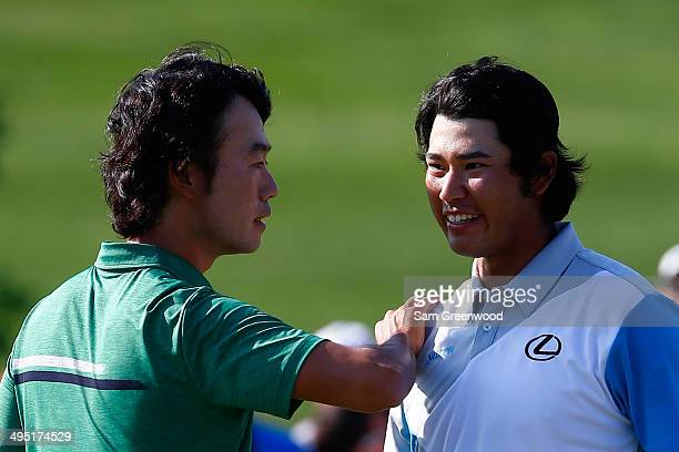 Hideki Matsuyama of Japan is congratulated by Kevin Na after winning the Memorial Tournament presented by Nationwide Insurance in a playoff at...