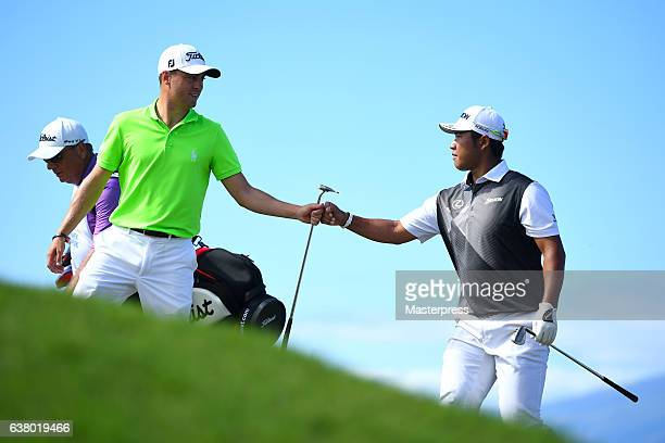 Hideki Matsuyama of Japan is congratulated his chipin eagle by Justin Thomas of the United States on the 14th hole during the final round of the SBS...