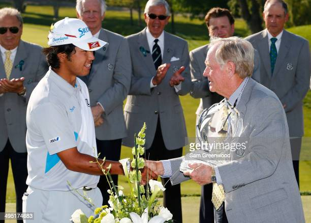 Hideki Matsuyama of Japan is presented the trophy by Jack Nicklaus after winning the Memorial Tournament presented by Nationwide Insurance at...
