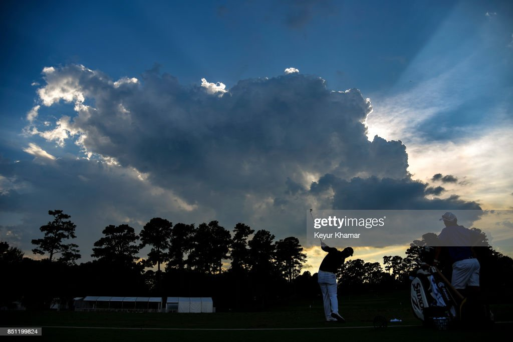 Hideki Matsuyama of Japan is silhouetted by the setting sun as he hits balls on the range following the first round of the TOUR Championship, the final event of the FedExCup Playoffs, at East Lake Golf Club on September 21, 2017 in Atlanta, Georgia.