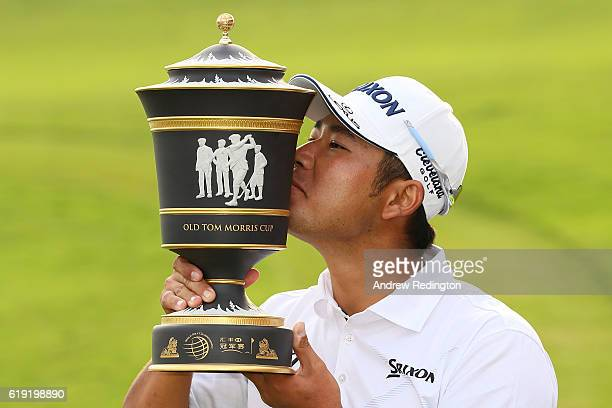 Hideki Matsuyama of Japan kisses the trophy following his victory during day four of the WGC HSBC Champions at Sheshan International Golf Club on...