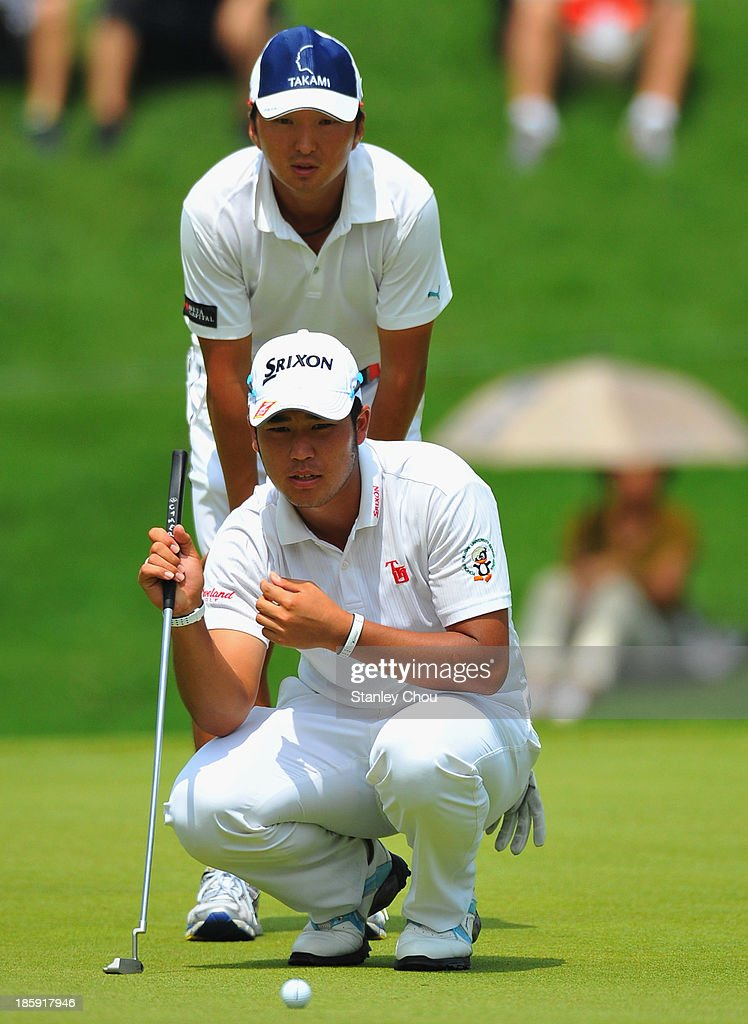 <a gi-track='captionPersonalityLinkClicked' href=/galleries/search?phrase=Hideki+Matsuyama&family=editorial&specificpeople=5566852 ng-click='$event.stopPropagation()'>Hideki Matsuyama</a> of Japan lines for a putt on the 9th hole during round three of the CIMB Classic at Kuala Lumpur Golf & Country Club on October 26, 2013 in Kuala Lumpur, Malaysia.