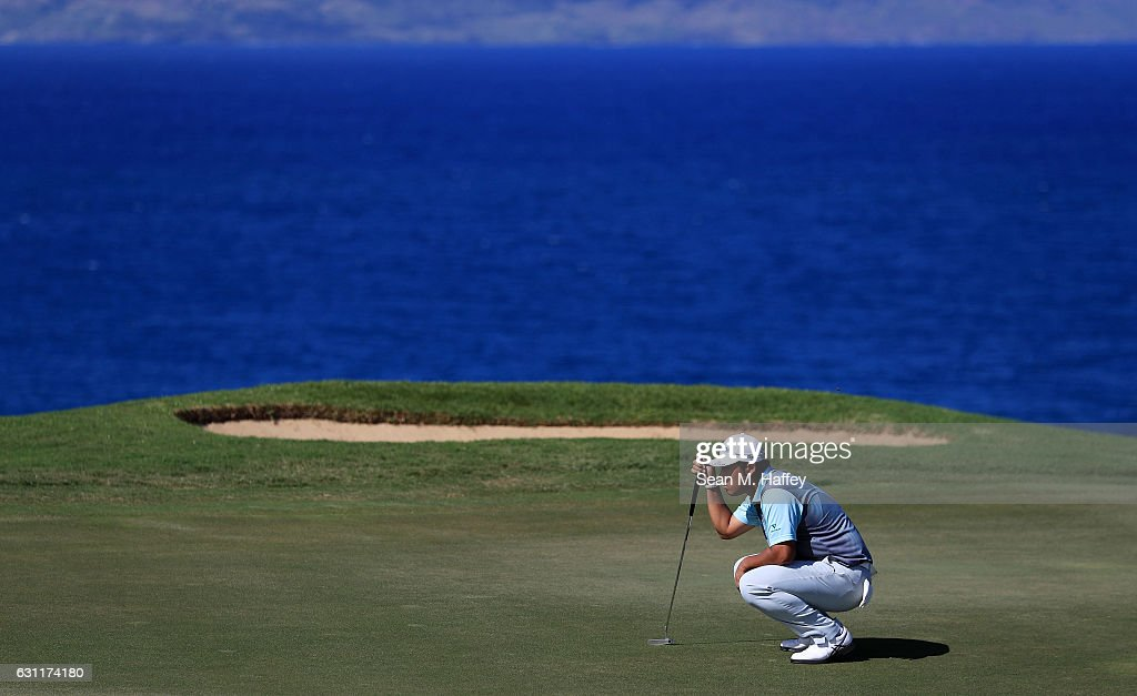 Hideki Matsuyama of Japan lines up a putt on the 12th green during the third round of the SBS Tournament of Champions at the Plantation Course at Kapalua Golf Club on January 7, 2017 in Lahaina, Hawaii.