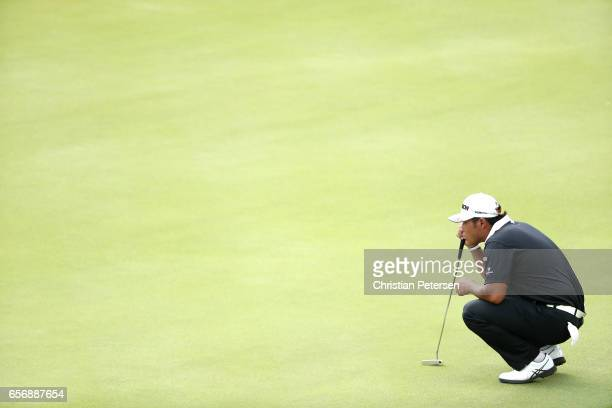 Hideki Matsuyama of Japan lines up a putt on the 2nd hole of his match during round two of the World Golf ChampionshipsDell Technologies Match Play...