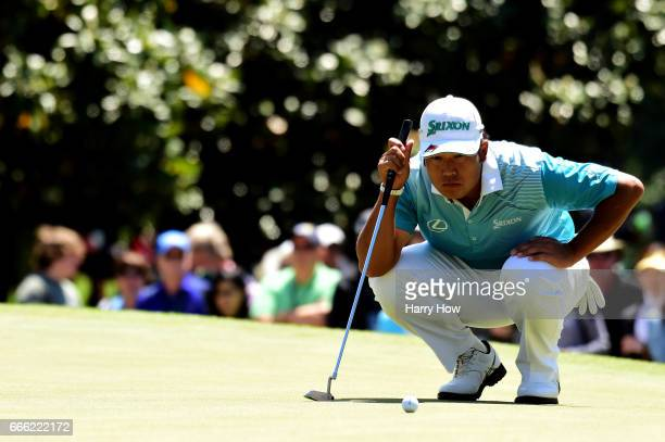 Hideki Matsuyama of Japan lines up a putt on the first hole during the third round of the 2017 Masters Tournament at Augusta National Golf Club on...