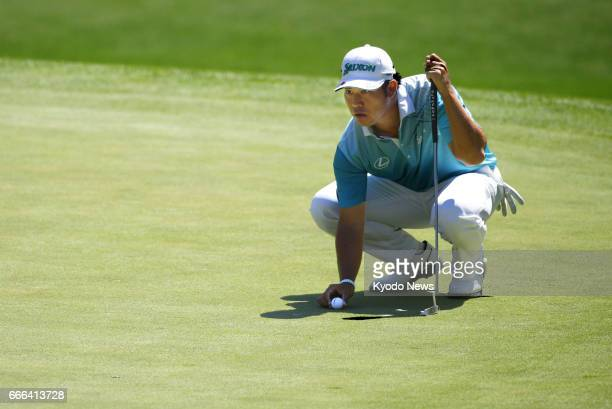 Hideki Matsuyama of Japan lines up a putt on the sixth green during the third round of the Masters Tournament at Augusta National Golf Club on April...
