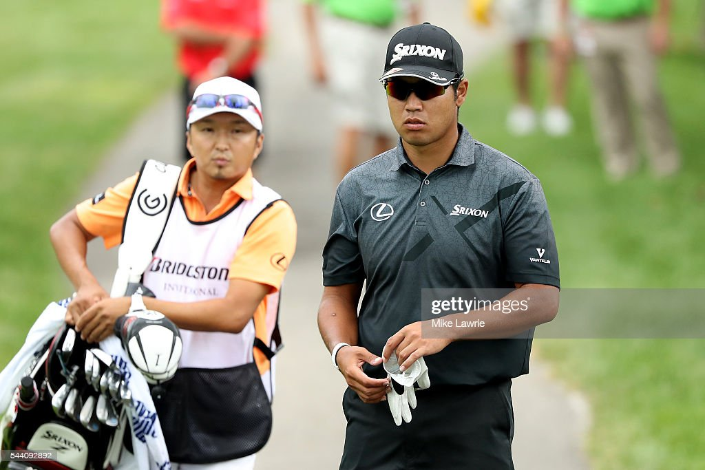 <a gi-track='captionPersonalityLinkClicked' href=/galleries/search?phrase=Hideki+Matsuyama&family=editorial&specificpeople=5566852 ng-click='$event.stopPropagation()'>Hideki Matsuyama</a> of Japan looks on with his caddie from the second fairway during the second round of the World Golf Championships - Bridgestone Invitational at Firestone Country Club South Course on July 1, 2016 in Akron, Ohio.