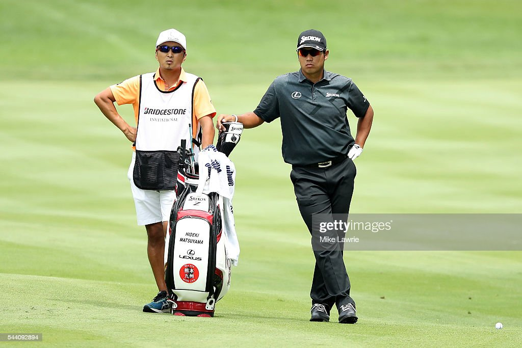 Hideki Matsuyama of Japan looks on with his caddie from the second fairway during the second round of the World Golf Championships - Bridgestone Invitational at Firestone Country Club South Course on July 1, 2016 in Akron, Ohio.