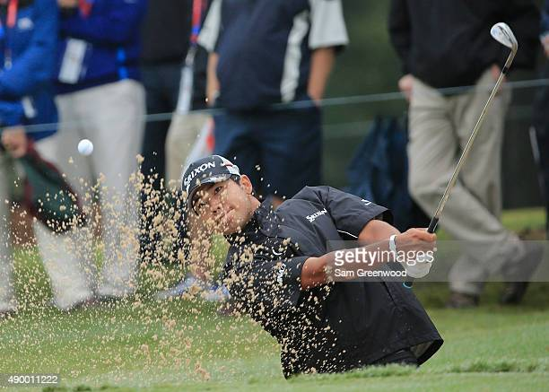 Hideki Matsuyama of Japan plays a bunker shot on the first hole during the second round of the TOUR Championship By CocaCola at East Lake Golf Club...