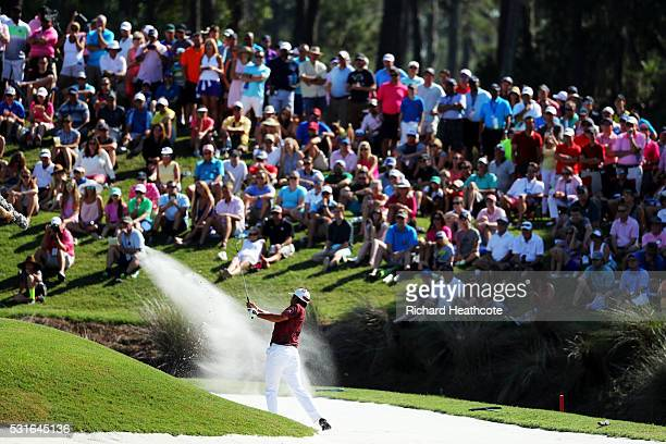 Hideki Matsuyama of Japan plays a shot from a bunker on the 11th hole during the final round of THE PLAYERS Championship at the Stadium course at TPC...