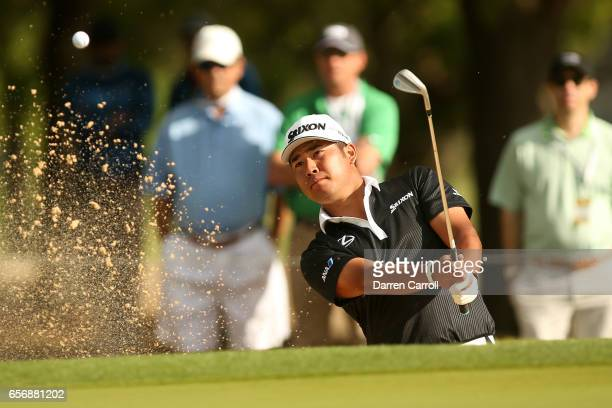 Hideki Matsuyama of Japan plays a shot from a bunker on the 1st hole of his match during round two of the World Golf ChampionshipsDell Technologies...