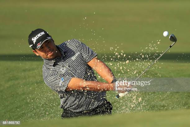 Hideki Matsuyama of Japan plays a shot from a bunker on the tenth hole during the first round of THE PLAYERS Championship at the Stadium course at...