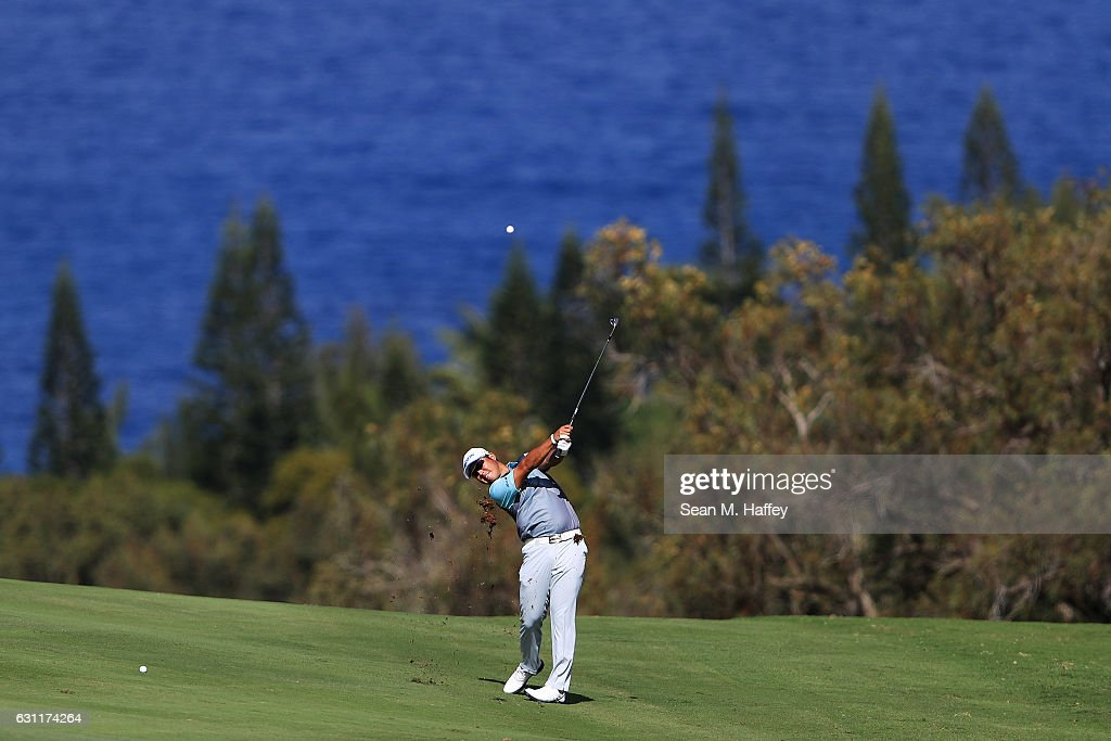 Hideki Matsuyama of Japan plays a shot on the fourth hole during the third round of the SBS Tournament of Champions at the Plantation Course at Kapalua Golf Club on January 7, 2017 in Lahaina, Hawaii.