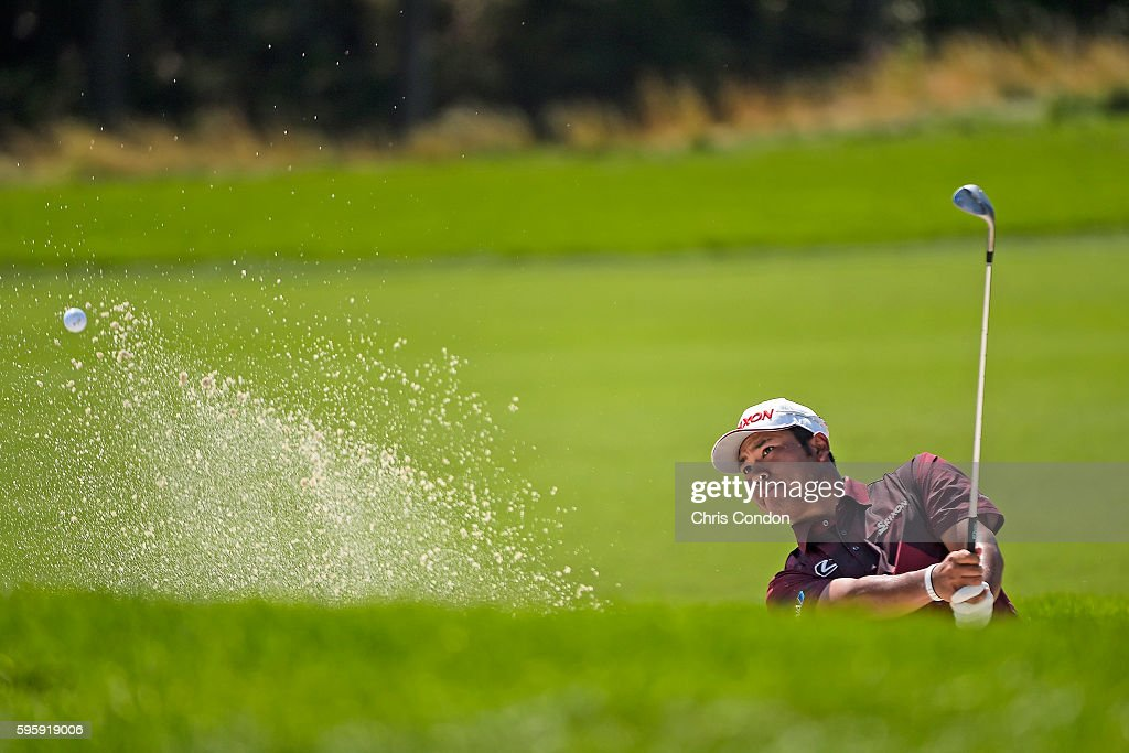 Hideki Matsuyama of Japan plays from a bunker on the 4th green during the second round of The Barclays at Bethpage State Park on August 26 2016 in...
