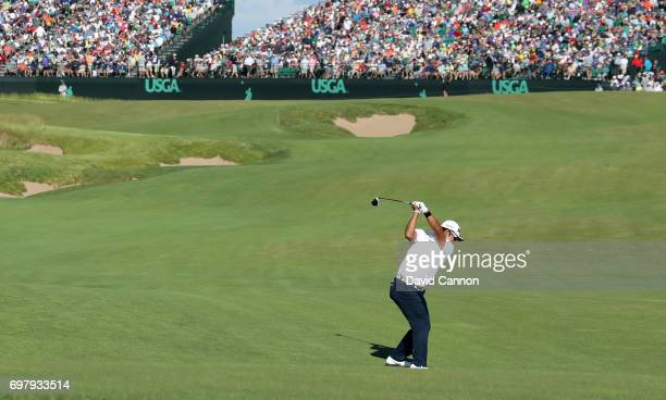 Hideki Matsuyama of Japan plays his second shot at the par 5 18th hole during the final round of the 117th US Open Championship at Erin Hills on June...