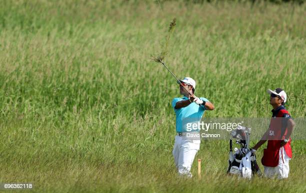 Hideki Matsuyama of Japan plays his second shot from deep rough on the par 5 14th hole during the first round of the 117th US Open Championship at...