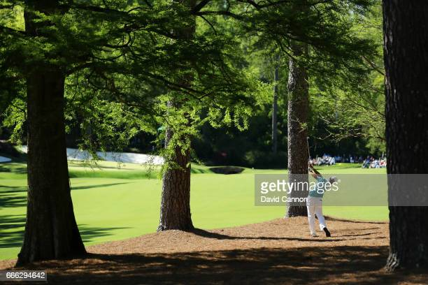 Hideki Matsuyama of Japan plays his second shot on the 13th hole during the third round of the 2017 Masters Tournament at Augusta National Golf Club...