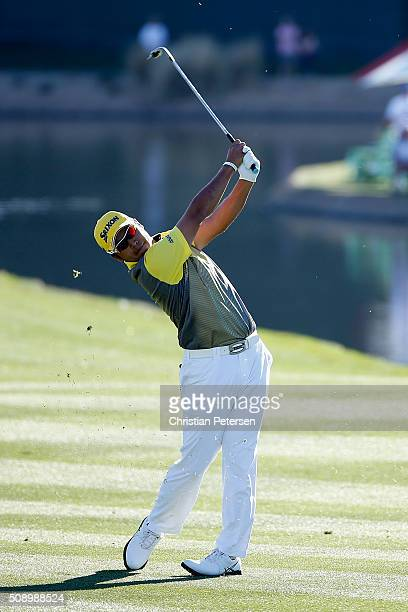 Hideki Matsuyama of Japan plays his second shot on the 18th hole during the final round of the Waste Management Phoenix Open at TPC Scottsdale on...