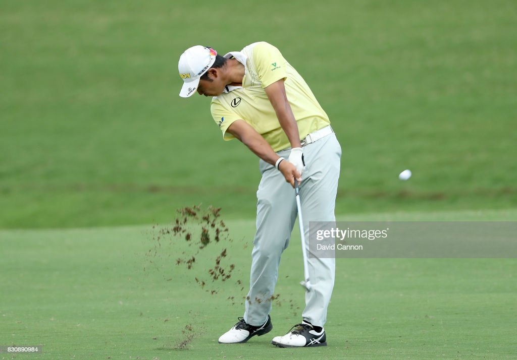 Hideki Matsuyama of Japan plays his second shot on the par 4, 18th hole during the third round of the 2017 PGA Championship at Quail Hollow on August 12, 2017 in Charlotte, North Carolina.