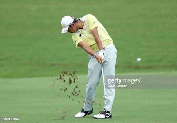 Hideki Matsuyama of Japan plays his second shot on the par 4 18th hole during the third round of the 2017 PGA Championship at Quail Hollow on August...