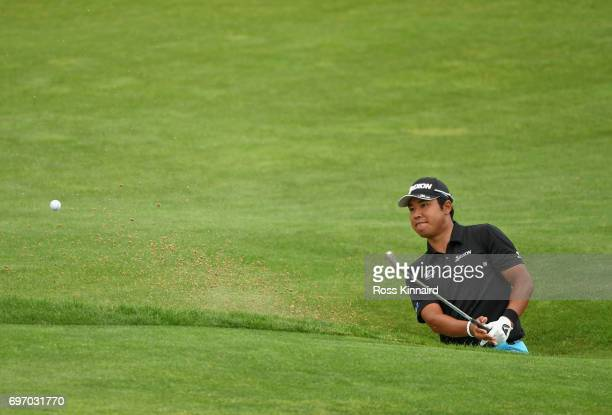 Hideki Matsuyama of Japan plays his shot from a bunker on the 15th hole during the third round of the 2017 US Open at Erin Hills on June 17 2017 in...