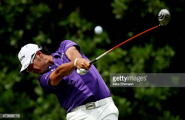 Hideki Matsuyama of Japan plays his shot from the 11th tee during round two of THE PLAYERS Championship at the TPC Sawgrass Stadium course on May 8...