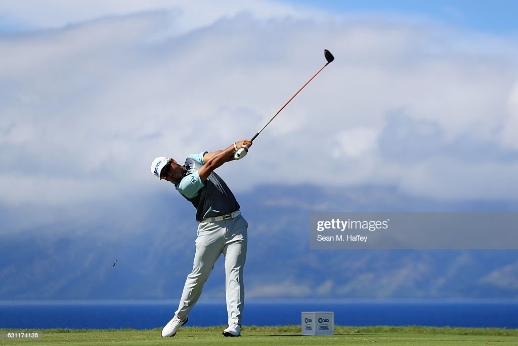 Hideki Matsuyama of Japan plays his shot from the 13th tee during the third round of the SBS Tournament of Champions at the Plantation Course at Kapalua Golf Club on January 7, 2017 in Lahaina, Hawaii.