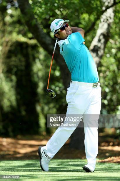 Hideki Matsuyama of Japan plays his shot from the second tee during the third round of the 2017 Masters Tournament at Augusta National Golf Club on...