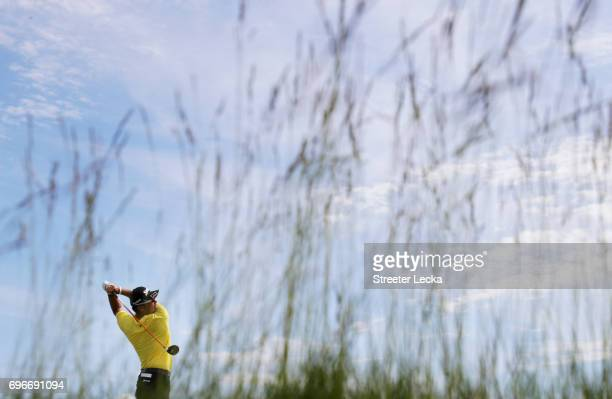 Hideki Matsuyama of Japan plays his shot from the seventh tee during the second round of the 2017 US Open at Erin Hills on June 16 2017 in Hartford...