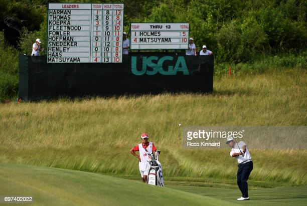 Hideki Matsuyama of Japan plays his shot on the 14th hole during the final round of the 2017 US Open at Erin Hills on June 18 2017 in Hartford...