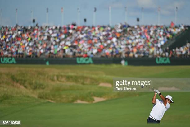 Hideki Matsuyama of Japan plays his shot on the 18th hole during the final round of the 2017 US Open at Erin Hills on June 18 2017 in Hartford...