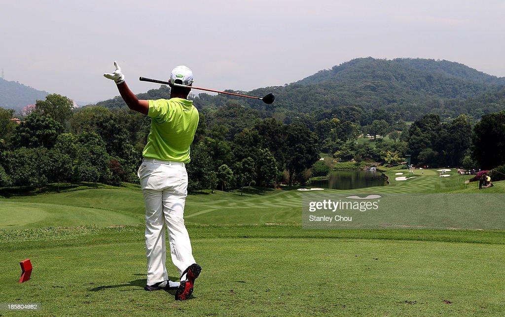Hideki Matsuyama of Japan plays his tee shot on the 2nd hole during round two of the CIMB Classic at Kuala Lumpur Golf & Country Club on October 25, 2013 in Kuala Lumpur, Malaysia.
