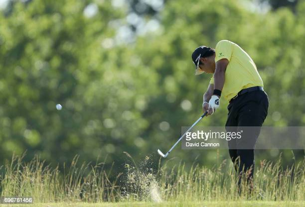 Hideki Matsuyama of Japan plays his tee shot on the par 3 16th hole during the second round of the 117th US Open Championship at Erin Hills on June...