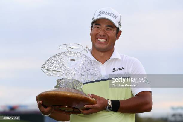 Hideki Matsuyama of Japan poses with the trophy after winning the Waste Management Phoenix Open on the fourth playoff hole at TPC Scottsdale on...