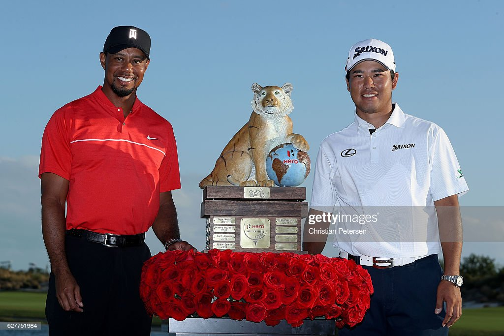Hideki Matsuyama (R) of Japan poses with the trophy and host Tiger Woods after winning the Hero World Challenge at Albany, The Bahamas on December 4, 2016 in Nassau, Bahamas.