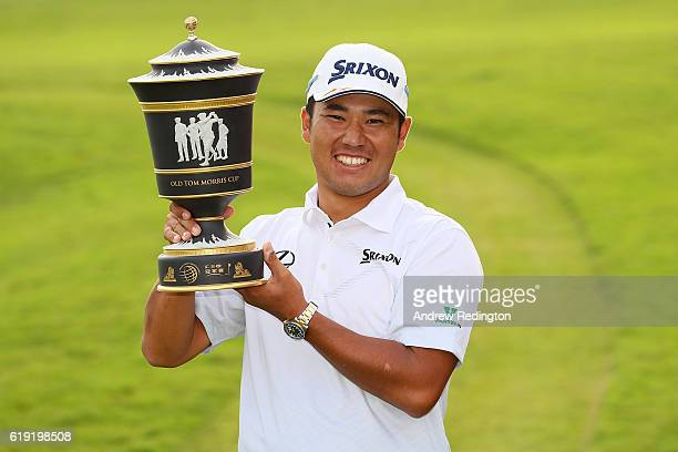 Hideki Matsuyama of Japan poses with the trophy following his victory during day four of the WGC HSBC Champions at Sheshan International Golf Club on...