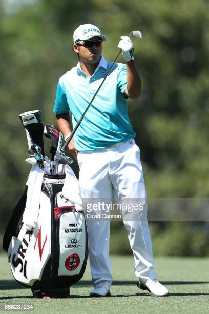 Hideki Matsuyama of Japan prepares to play his second shot on the fifth hole during the third round of the 2017 Masters Tournament at Augusta...