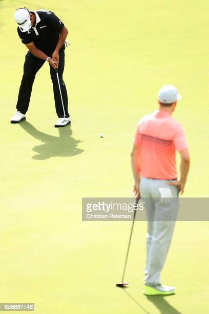 Hideki Matsuyama of Japan putts on the 2nd hole of his match against Ross Fisher of England during round two of the World Golf ChampionshipsDell...