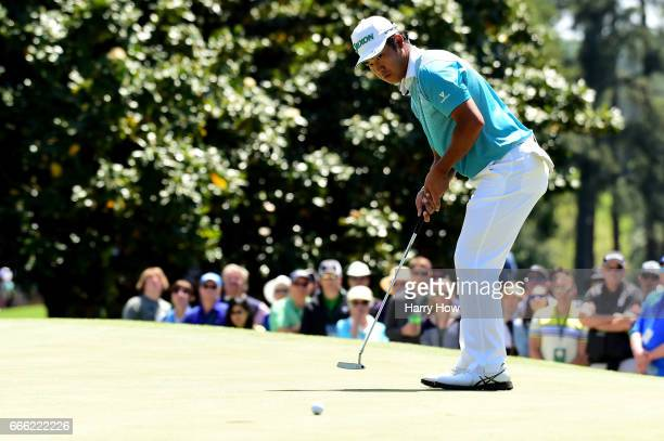 Hideki Matsuyama of Japan putts on the first hole during the third round of the 2017 Masters Tournament at Augusta National Golf Club on April 8 2017...