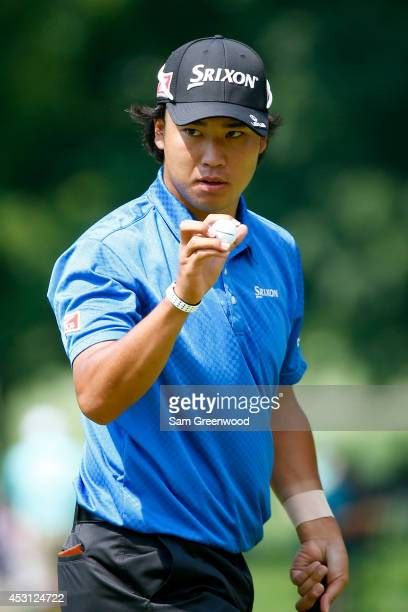 Hideki Matsuyama of Japan reacts after a putt on the first green during the final round of the World Golf ChampionshipsBridgestone Invitational at...
