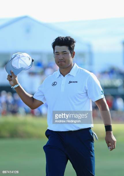 Hideki Matsuyama of Japan reacts after finishing on the 18th green during the final round of the 2017 US Open at Erin Hills on June 18 2017 in...