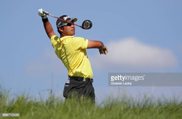 Hideki Matsuyama of Japan reacts after his shot from the 11th tee during the second round of the 2017 US Open at Erin Hills on June 16 2017 in...