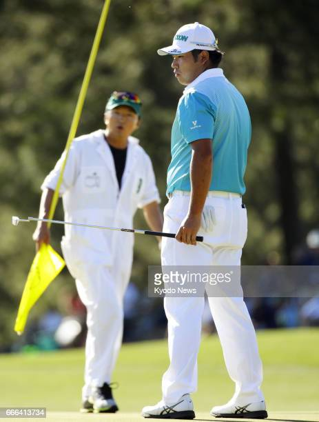 Hideki Matsuyama of Japan reacts after missing his birdie putt on the 17th hole during the third round of the Masters Tournament at Augusta National...