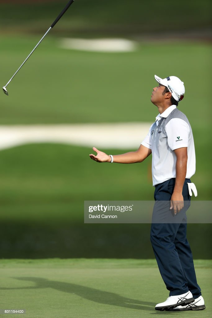 Hideki Matsuyama of Japan reacts by throwing his putter as he just misses a short par putt on the par 4, 16th hole during the final round of the 2017 PGA Championship at Quail Hollow on August 13, 2017 in Charlotte, North Carolina.