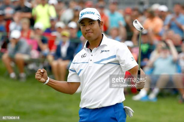 Hideki Matsuyama of Japan reacts on the 18th green after putting for birdie during the final round of the World Golf Championships Bridgestone...